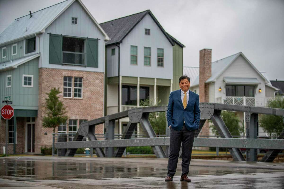 Developer Frank Liu stands on a bridge in the Kolbe Farms neighborhood, a development by InTown Homes, in the Spring Branch area of Houston, Tuesday, Dec. 10, 2019.