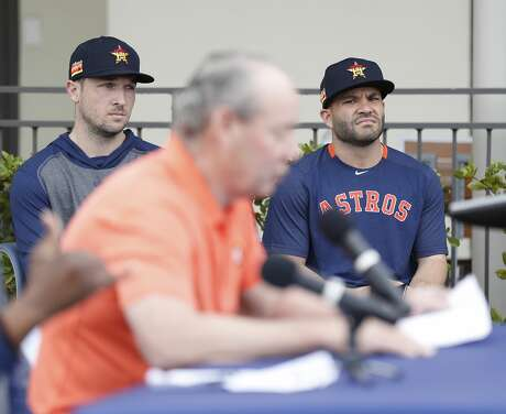 Houston Astros Alex Bregman and Jose Altuve listen to owner Jim Crane address sign-stealing scandal during a press conference before the start of the first day of the Houston Astros spring training camp at the Fitteam Ballpark of The Palm Beaches, in West Palm Beach , Thursday, Feb. 13, 2020.