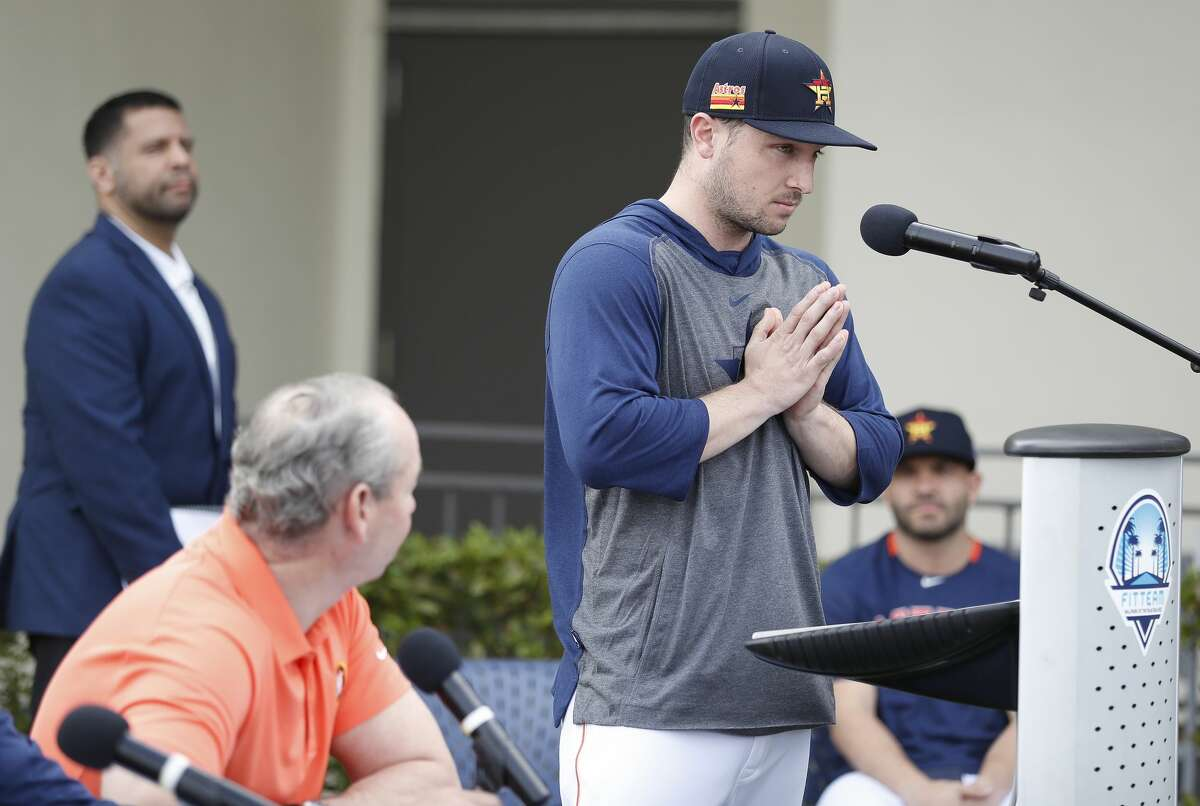 Houston Astros Alex Bregman puts his hands together as he apologized to owner Jim Crane and fans as he addressed sign-stealing scandal during a press conference before the start of the first day of the Houston Astros spring training camp at the Fitteam Ballpark of The Palm Beaches, in West Palm Beach , Thursday, Feb. 13, 2020.