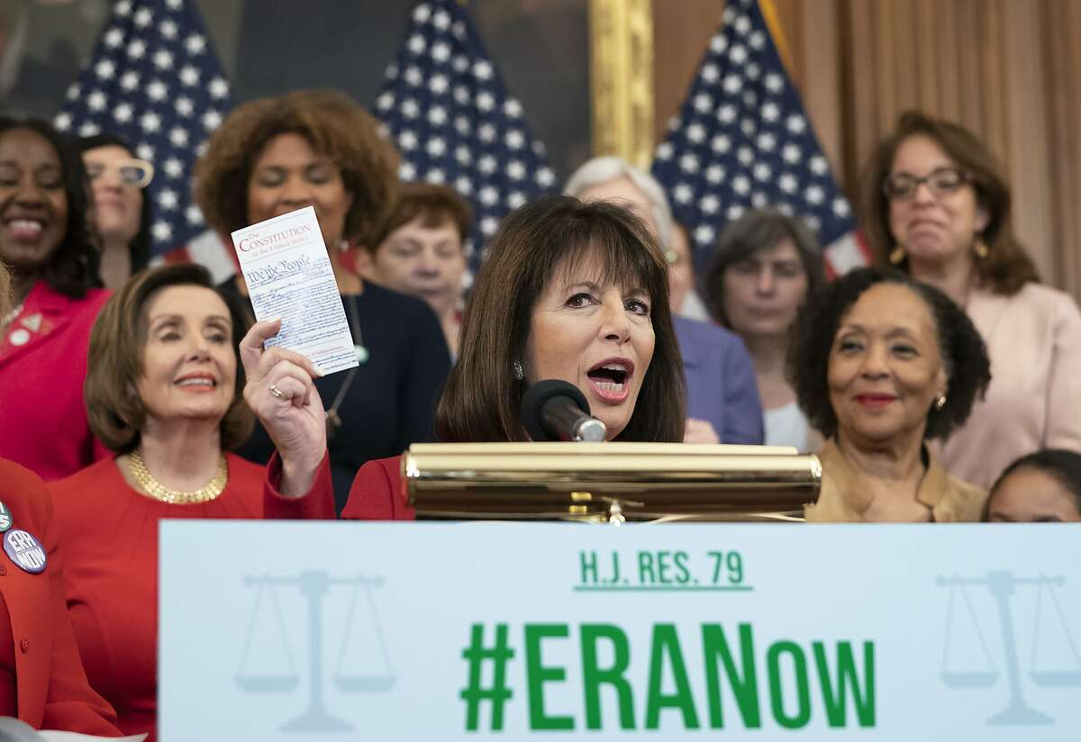 Rep. Jackie Speier, D-Calif., flanked by Speaker of the House Nancy Pelosi, D-Calif., left, and ERA Coalition Co-President and CEO Carol Jenkins, right, holds up a copy of the Constitution during an event about their resolution to remove the deadline for ratification of the Equal Rights Amendment, at the Capitol in Washington, Wednesday, Feb. 12, 2020. (AP Photo/J. Scott Applewhite)