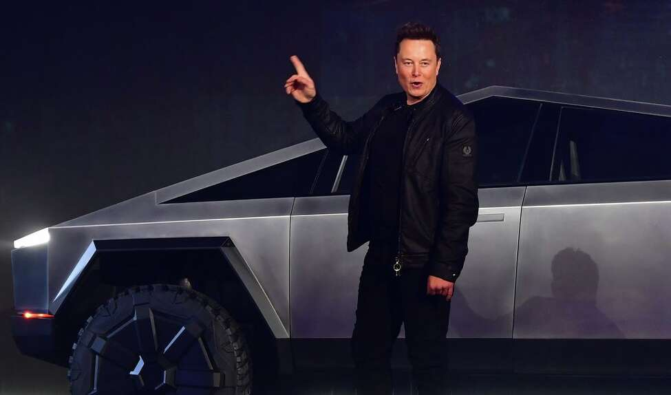 (FILES) In this file photo taken on November 21, 2019 Tesla co-founder and CEO Elon Musk gestures while introducing the newly unveiled all-electric battery-powered Tesla Cybertruck at Tesla Design Center in Hawthorne, California. - Tesla shares dived around 20 percent in early afternoon trading February 5, 2020, giving back some of the gains the electric-car maker racked up since October. Shares stood at $723.92, down 18.3 percent around 1835 GMT, reversing a nearly unbroken trend over the last four months that accelerated this week when the stock jumped more than 36 percent in a two-day surge. (Photo by Frederic J. BROWN / AFP)