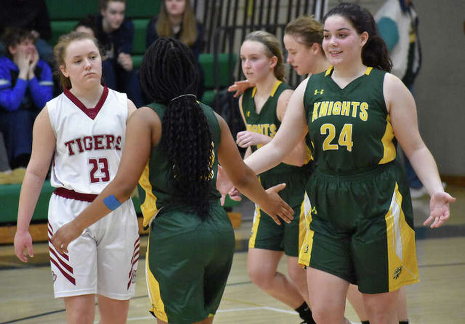 Metro-East Lutheran's Emma Daniel, right, celebrates with Destiny Williams after the Knights pulled out a regional semifinal win over Dupo. Photo: Matt Kamp|The Intelligencer