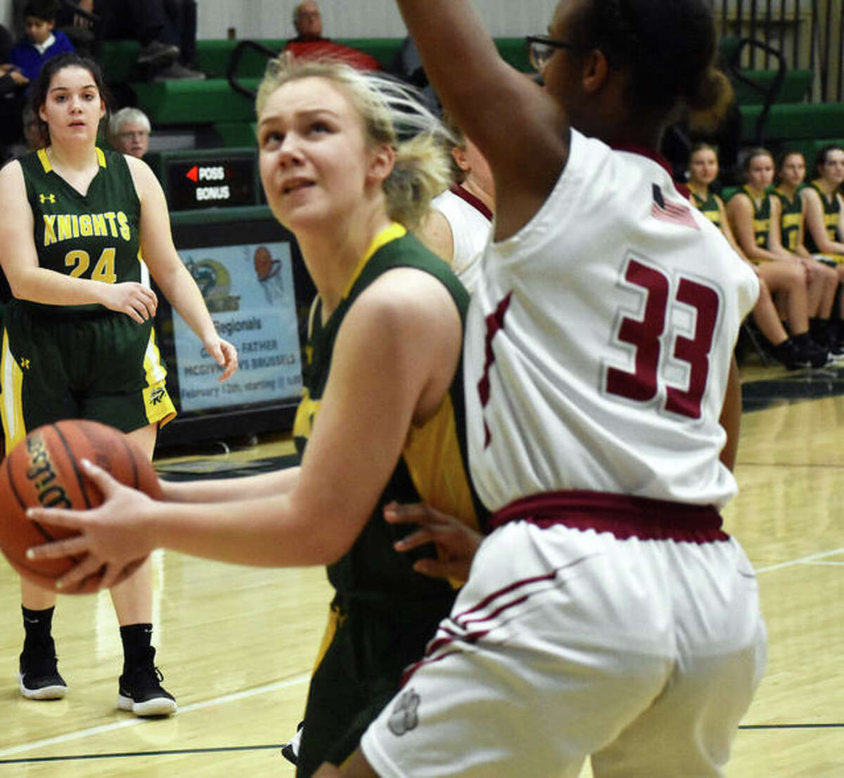 Metro-East Lutheran forward Jennifer Leitner looks to put up a shot over Dupo center Olivia Heidelberg in the first quarter.