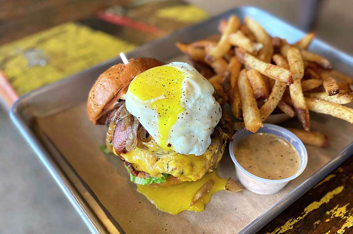 Custom options include a double-meat cheeseburger with bacon, a fried egg and sauteed onions with au poivre