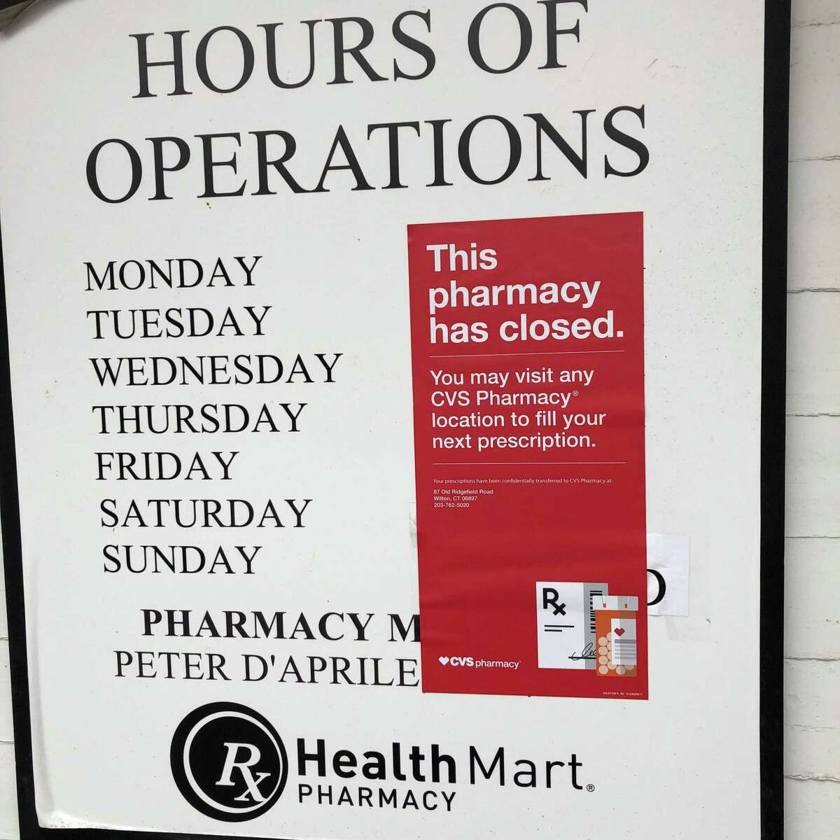 A sign posted on the Lang's Pharmacy in Wilton on Thursday, Feb. 13, announces that the pharmacy has closed and advises customers to fill their prescriptions at CVS Pharmacy.