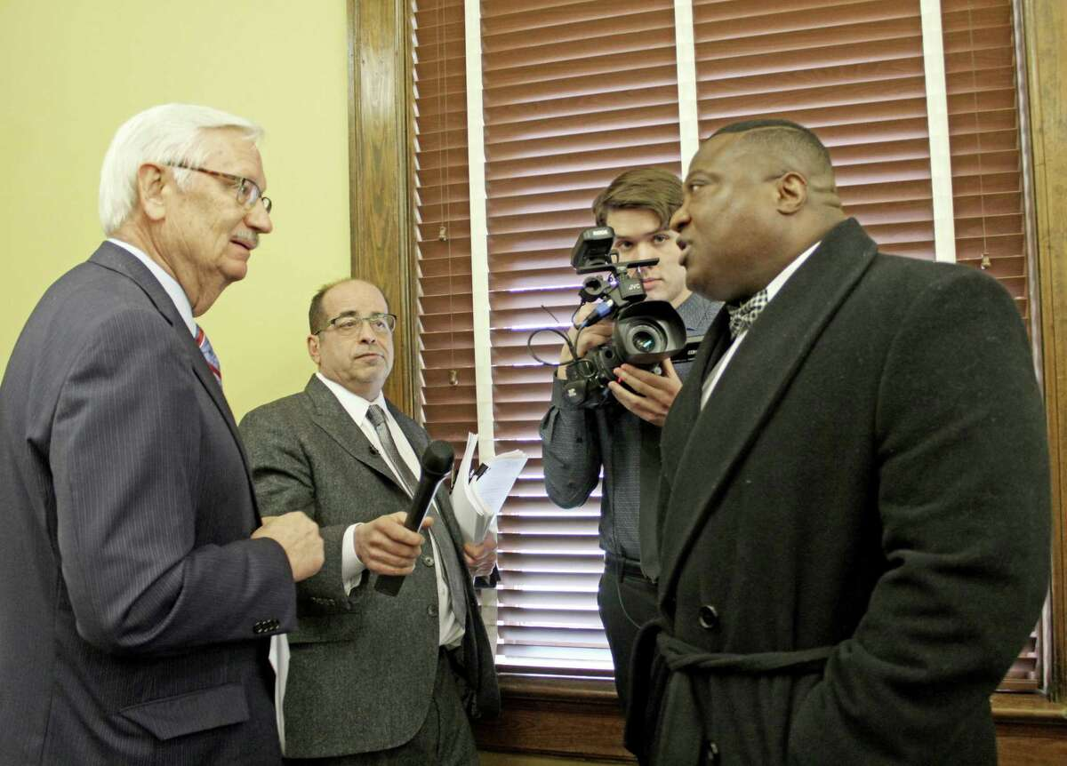 Acitivist Quannel X (right) confronts Fort Bend County Attorney Roy Cordes (left) during an interview with media consultant and former TV reporter Wayne Dolcefino (center) at the Fort Bend County Courthouse on Tuesday, Feb. 12.