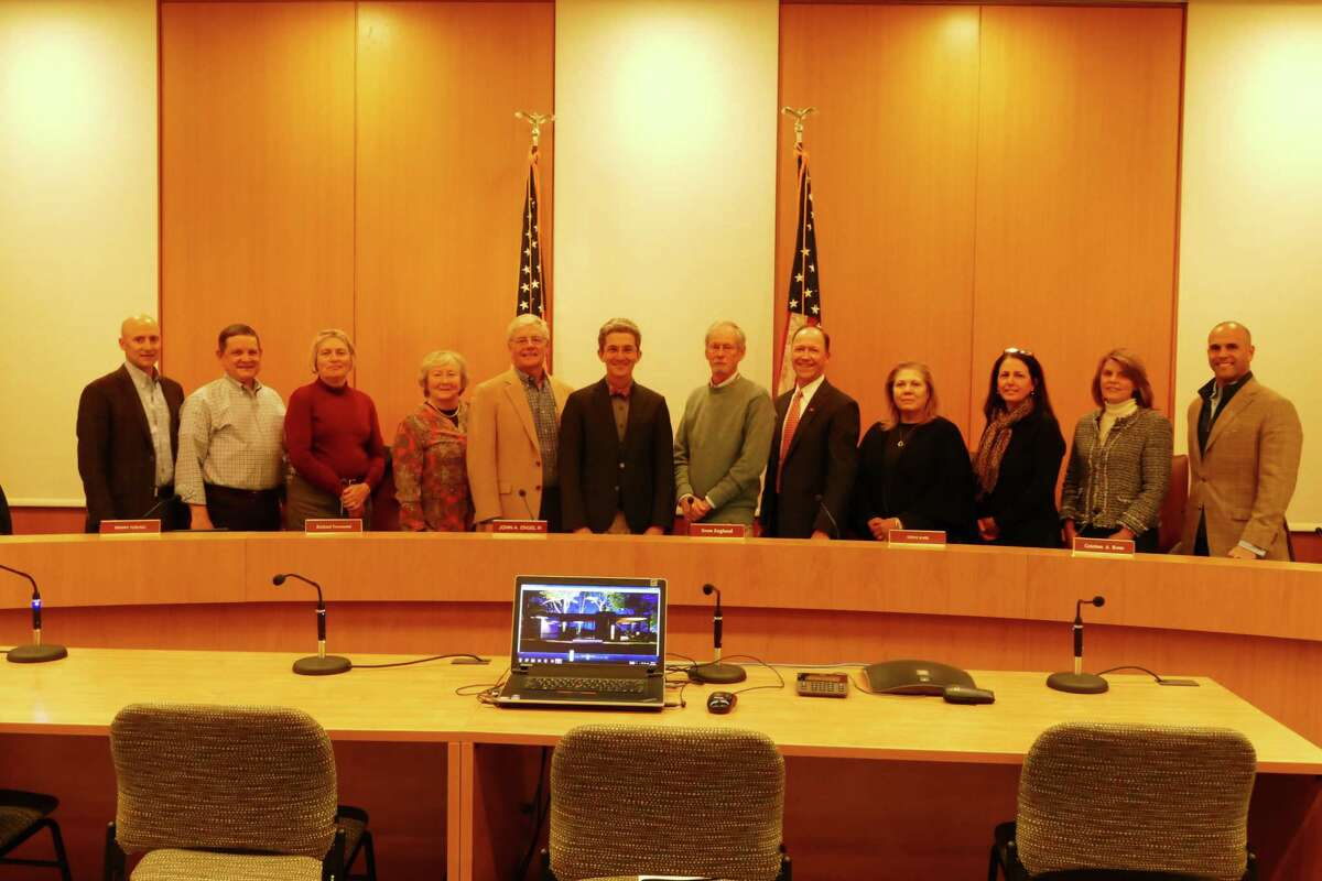 The new Town Council in New Canaan lined up for a picture after they chose their new leadership in Town Hall on November 13, 2019. From left to right, Mark Gryzmski, Tom Butterworth, Liz Donovan, Penny Young, Richard Townsend, John Engel, Sven Englund, Steve Karl, Christina Aquirre-Ross, Maria Naughton, Robin Bates-Mason and Mike Mauro.