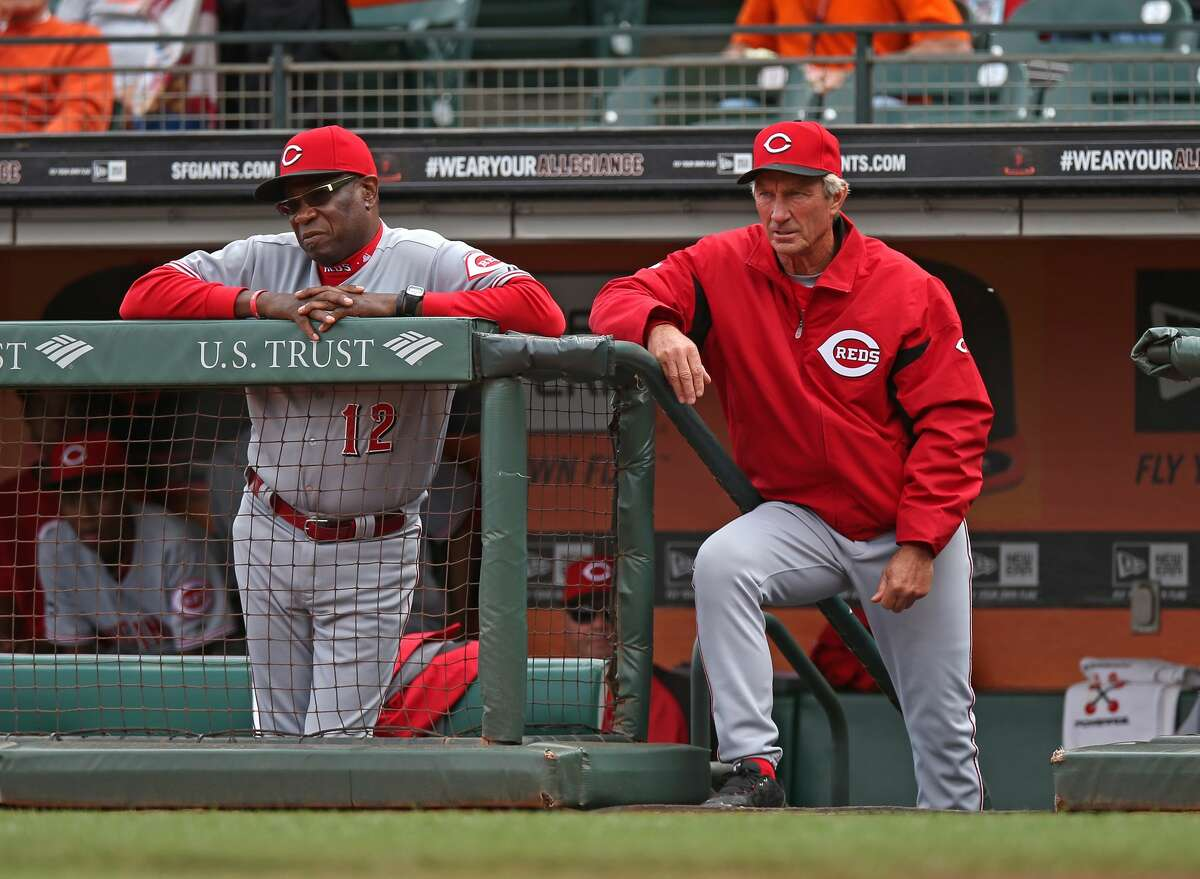 SAN FRANCISCO, CA - JULY 23: Manager Dusty Baker #12 and coach Chris Speier #35 of the Cincinnati Reds watch the game against the San Francisco Giants at AT&T Park on Tuesday, July 23, 2013 in San Francisco, California. (Photo by Brad Mangin/MLB Photos via Getty Images)