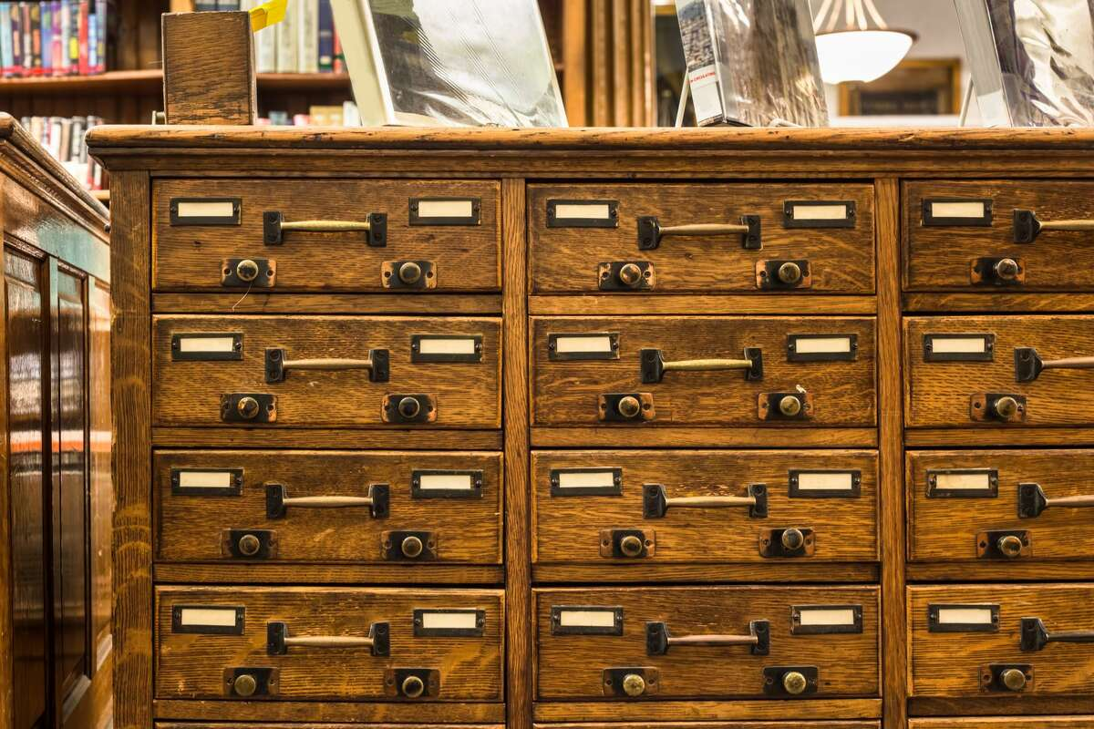 Card catalogs. The old-fashioned reference system is dead, and the drawers upon drawers of paper cards have mostly disappeared from school. School library catalog systems are now mostly online.