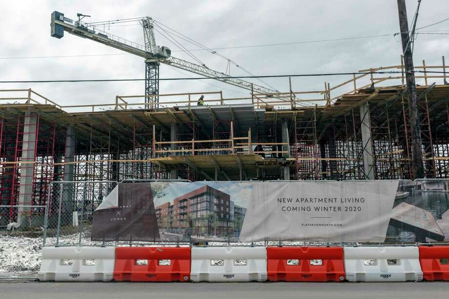 The still-under-construction Flats at River North apartments at the corner Jones Avenue and Broadway are seen in a Feb. 12, 2020 photo. Photo: William Luther / ©2020 San Antonio Express-News