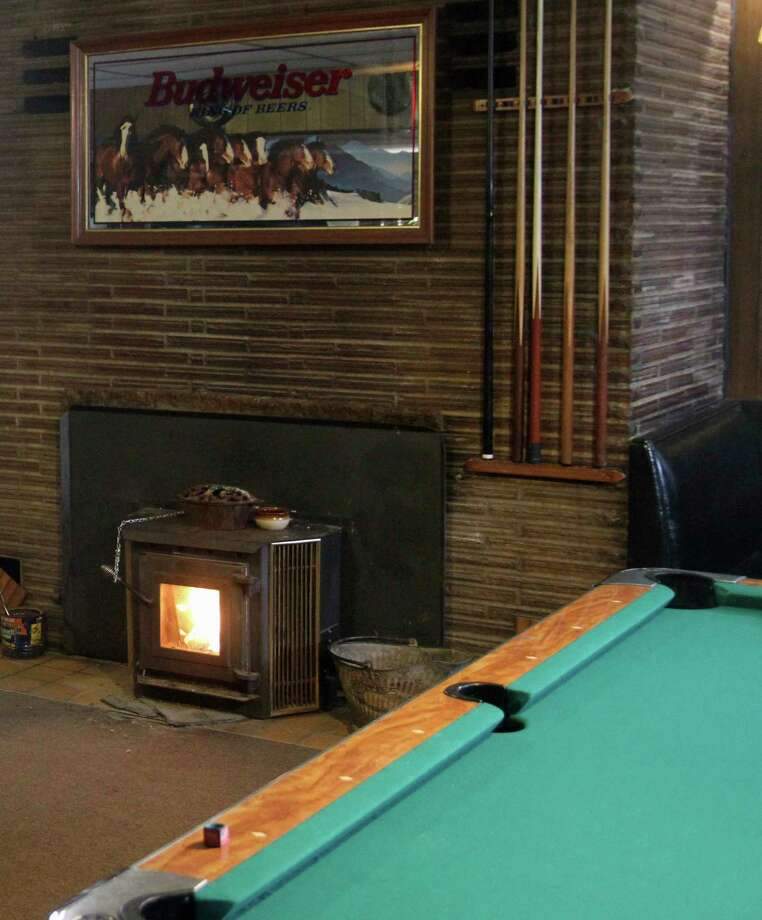 With a pool table nearby to pass the time, customers are encouraged to stay busy when the bar is crowded.