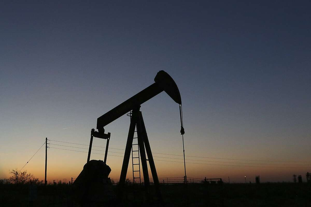 FILE - In this June 11, 2019, photo a pump jack operates in an oil field in the Permian Basin in Texas. (Jacob Ford/Odessa American via AP, File)