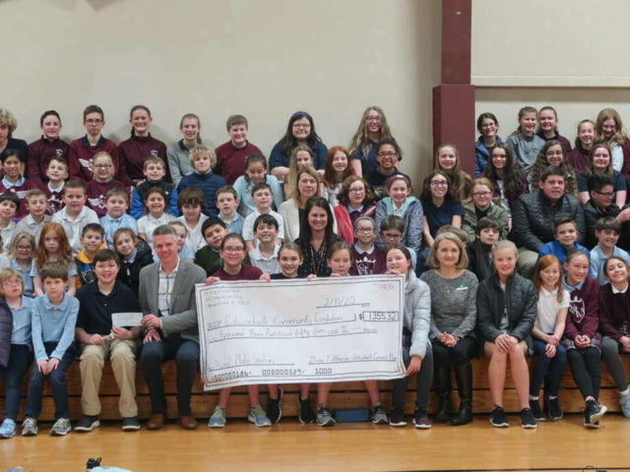 Students at St. Mary's gathered for an assembly in honor of $1,355 raised during Catholic Schools Week for the Nickel Plate Station restoration project in Edwardsville.