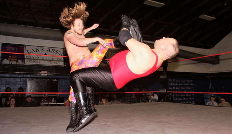 Zach Overton catches his opponent with a big boot at PWA's January 25 event in Springfield. Photo: Photo Courtesy Gary A. Jones, Springfield