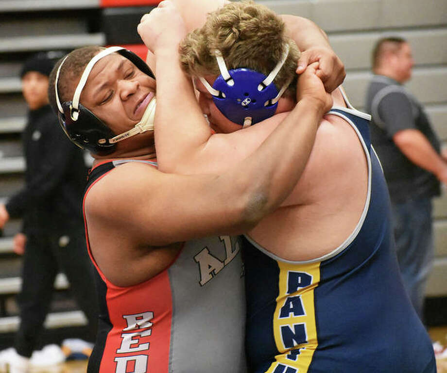 Alton's Kyle Hughes (left) engages with O'Fallon's Mason Baker during the third-place bout at 285 pounds Saturday in the Granite City Class 3A Regional. Hughes won by pin in the second period to advance to the Quincy Sectional. Photo: Matt Kamp | For The Telegraph