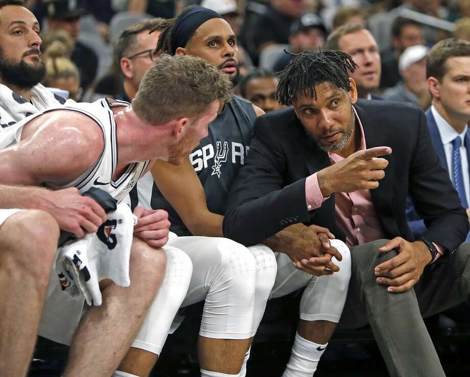 Tim Duncan assistant coach of the San Antonio Spurs talks with Jakob Poeltl #25 on Sunday, October 13, 2019. Photo: Ronald Cortes/Contributor