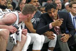 Tim Duncan assistant coach of the San Antonio Spurs talks with Jakob Poeltl #25 on Sunday, October 13, 2019.