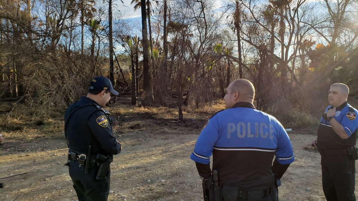 Laredo police officers oversee an area where a fire was recently reported at North Central Park. People with information on the case are asked to call police at 795-2800 or Laredo Crime Stoppers at 727-TIPS (8477).
