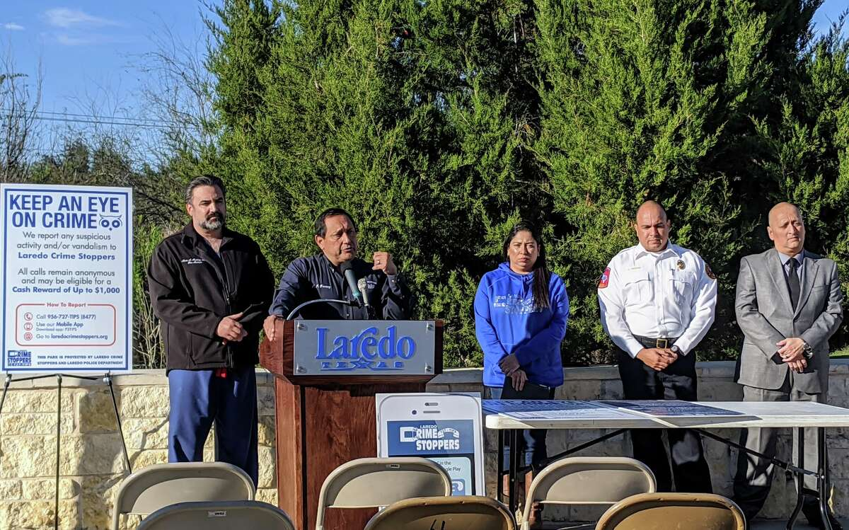 City of Laredo officials including Parks Director JJ Gomez, pictured at the podium, warned about the potential dangers a fire at North Central Park could cause to both trees and homes in the area on Wednesday.