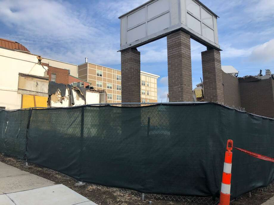 The structure at 427 Howe Avenue - former home to Dunkin' Donuts, among other businesses - is being razed, to be replaced by the Bridge Street Commons II. Photo: Brian Gioiele / Hearst Connecticut Media / Connecticut Post