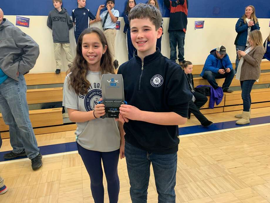 Saint Mary School Milford recently participated in a robotics competition at Corpus Christi School in Weathersfield. Each St. Mary team completed in 4 qualifying rounds in conjunction with different teams from 43 other schools. The team of Layla Alogna and William Bader placed first in the team-work competition and are invited to the state competition this March. Photo: Contributed Photo