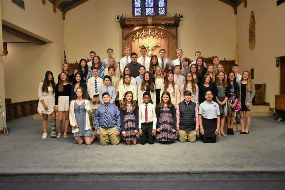 On Jan. 27, 24 new members were inducted into the National Junior Honor Society - St. Mary School Milford Chapter in St. Mary Church of Precious Blood Parish. These students exemplify excellence in the areas of scholarship, service, leadership, character and citizenship. Newly inducted members are: Lily Baird, Ava Bottino, Faith Doyle, Jackson Doyle, Bella Eyler, Gauge Forget, Suixian Gonzalez, Gabriella Grande, Charlotte LaVecchia, Jackson LaVecchia, Jack McInnis, Aubrie Nichols, Tyler Nickolenko, Mackenzie Pelosi, Caden Piselli, Kaleigh Richards, Mackenzie Richards, Tatum Santos, Megan Vella, Bridget Vitti, Audrey Voges, Maddie Wolfe, Bohdan Zazulak-Collins and Alyssa Zinker. They join current members Andrew Benjamin, Chase Bryant, Molly Ciuci, Danielle D'Avignon, Aida Ehlers, Griffin Fisher, John Gerrity, Fayrose Hussain, Daniel Kron, Taylor LaFountain, Max Lula, Alexi Paranal, Maya Pinto, Derek Rainey, Michael Roney, Gabriela Santiago, Matthew Savo, Abigail Savoie, Peter Swanson, Timothy Swanson, William Swanson, Atiana Tandon, Andrew Tkacs, Margaret Wetmore, Leni Wisniewski, Amanda Zurulo, Christopher Harry and Christopher DeProfio. Photo: Contributed Photo