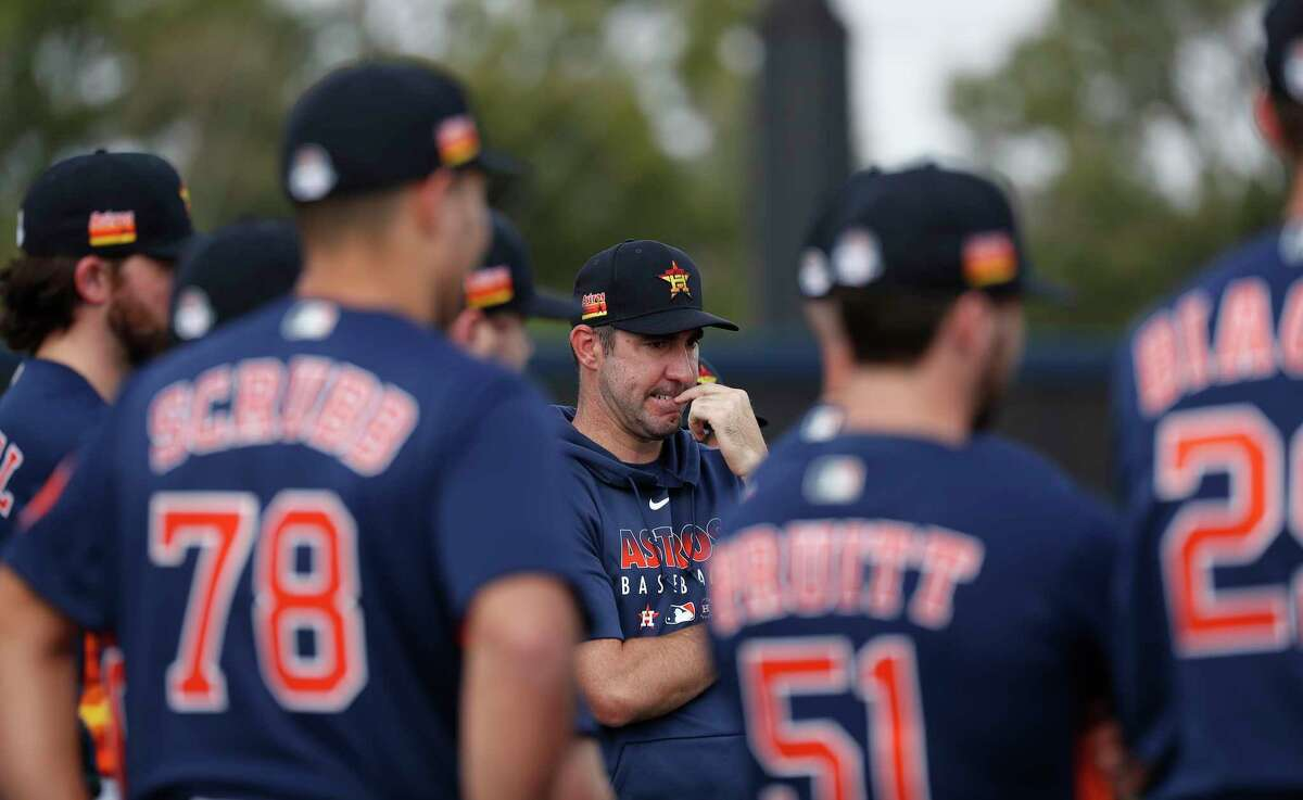 Houston Astros pitcher Justin Verlander listens during a first-day meeting with Astros pitching coach Brent Strom spring training workout at the Fitteam Ballpark of The Palm Beaches, in West Palm Beach , Thursday, Feb. 13, 2020.