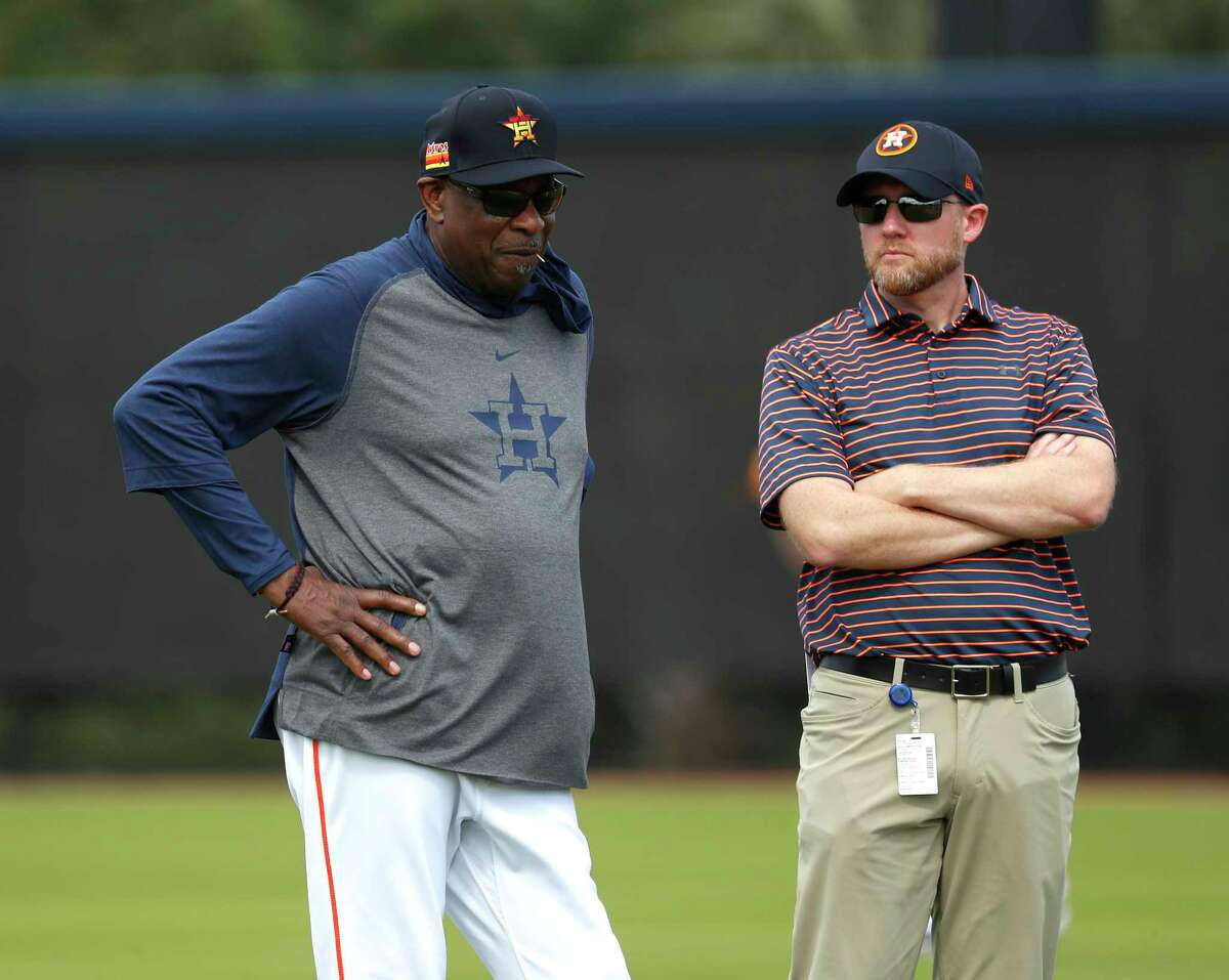 New Astros general manager James Click, right, watching spring training with Dusty Baker, has spent baseball's shutdown getting to know the baseball operations staff.