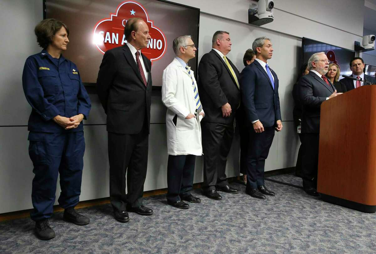"""Dr. John Hellerstedt, commissioner of the Texas Department of State Health Services (at podium), joins officials from the Centers for Disease Control and Prevention and other local and health officials for a news conference regarding the state's first case of COVID-19, or novel coronavirus, on Thursday, Feb. 13, 2020. Hellerstedt said the health system had worked """"exactly as planned."""""""