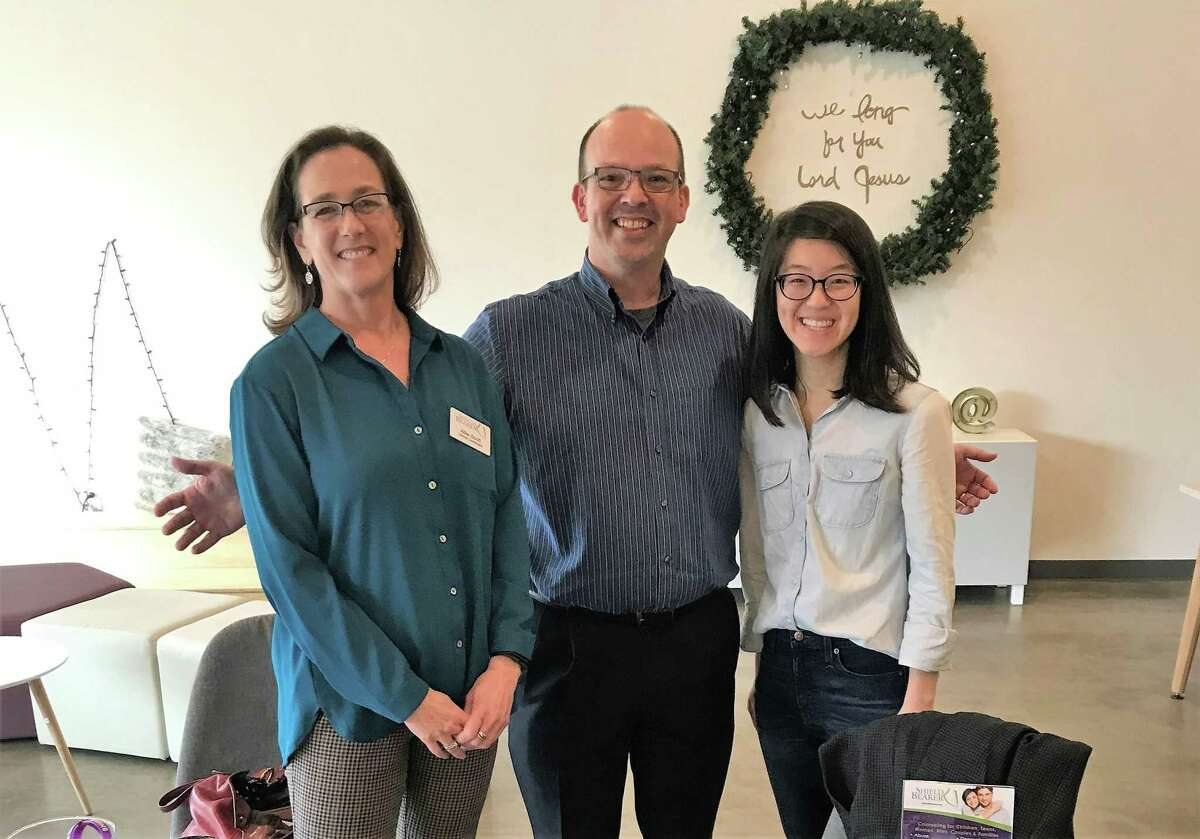 Allie Scott and Thad Cardine of Shield Bearer pose for a photo with Gloria Chen of Access Church in the office of Shield Bearer's newest counseling location in Spring Branch, which opened February 2020.
