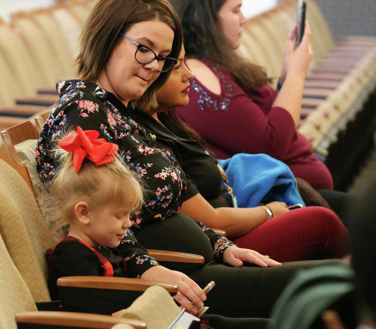 Stephanie Adams and her 4-year-old daughter, Madeline, attend the City Council session as members decide to put the renewal of funding for the city's Pre-K 4 SA program on the May ballot. The child is enrolled in the pre-kindergarten program.