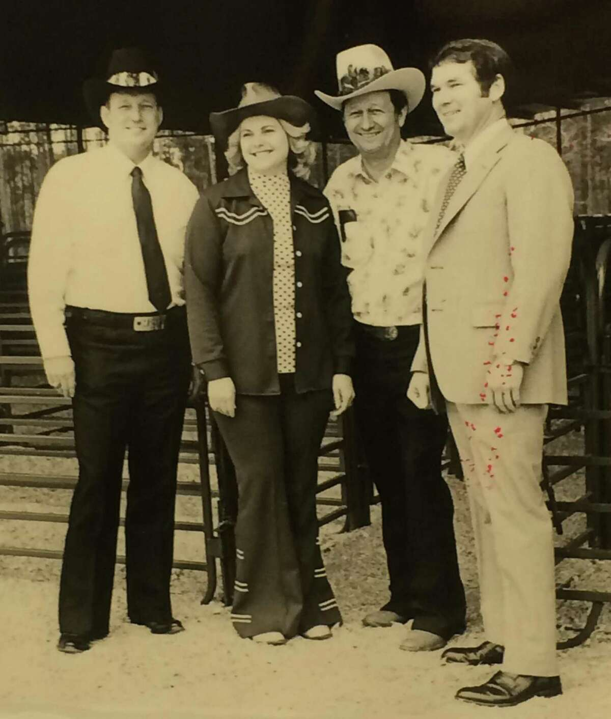 Bill Bergfeld Jr., second from right, is one of the Conroe businessman credited with starting the Go Texan Parade in Conroe. Others pictured from left are Don Buckalew, Martha Gustavson and Fred Greer promoting the Montgomery County Fair.