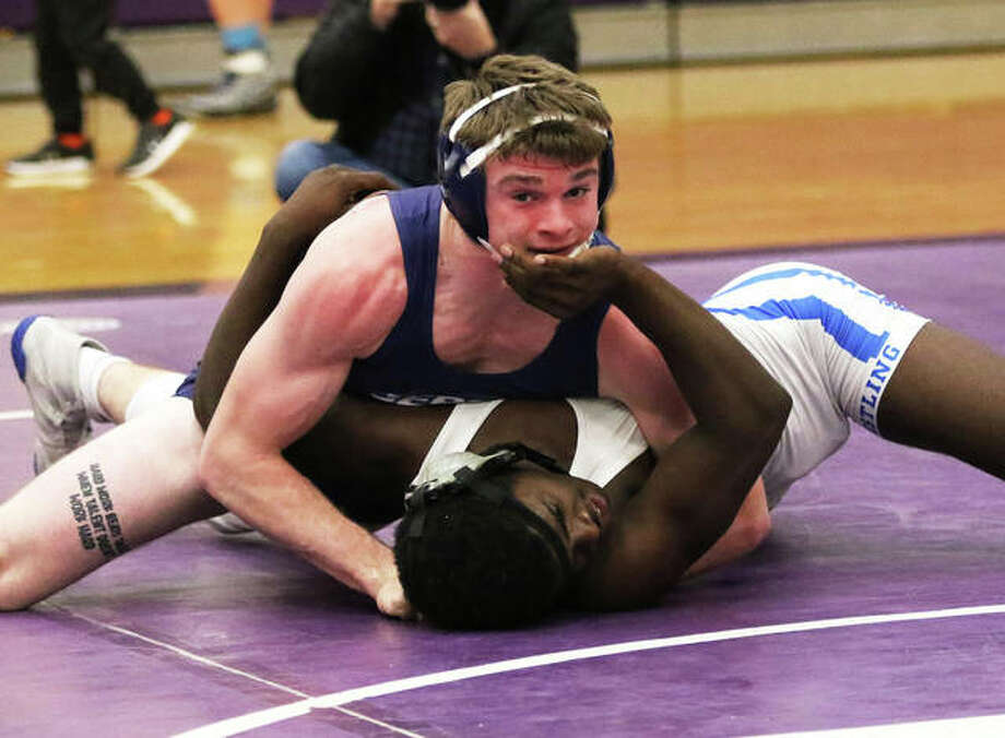 Jersey's Zeke Waltz (top) works on his pin of Cahokia's Jalon Strong in the 160-pound championship match at the Mascoutah Class 2A Regional on Saturday. Waltz takes a 37-0 record to the sectional back at Mascoutah. Photo: Greg Shashack / The Telegraph