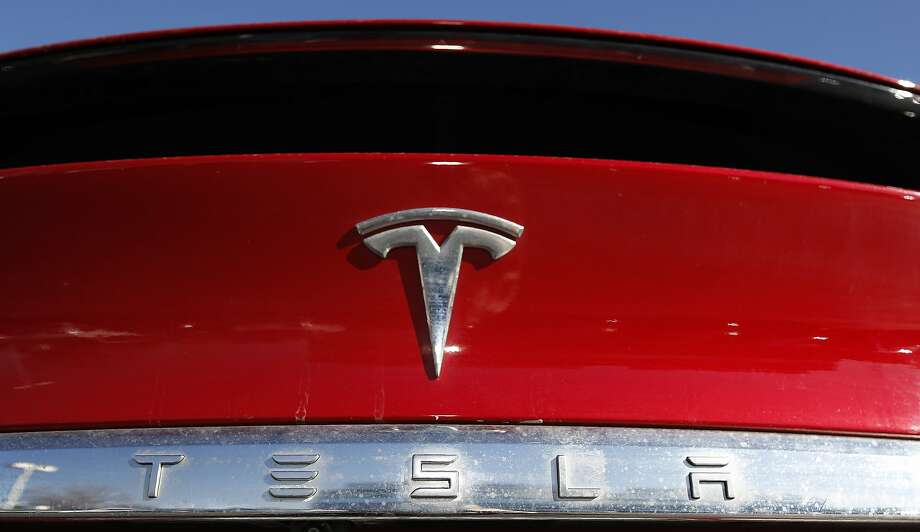 FILE - In this Feb. 2, 2020 file photograph, the company logo sits on an unsold 2020 Model X at a Tesla dealership in Littleton, Colo. Shares of Tesla Inc. fell 4% in early trading Thursday, Feb. 13, after the electric vehicle and solar panel maker said it would sell more than $2 billion worth of additional shares. The move comes just two weeks after CEO Elon Musk said the company had enough cash to fund its capital programs and it didn't need to raise any more money. (AP Photo/David Zalubowski, File) Photo: David Zalubowski, Associated Press