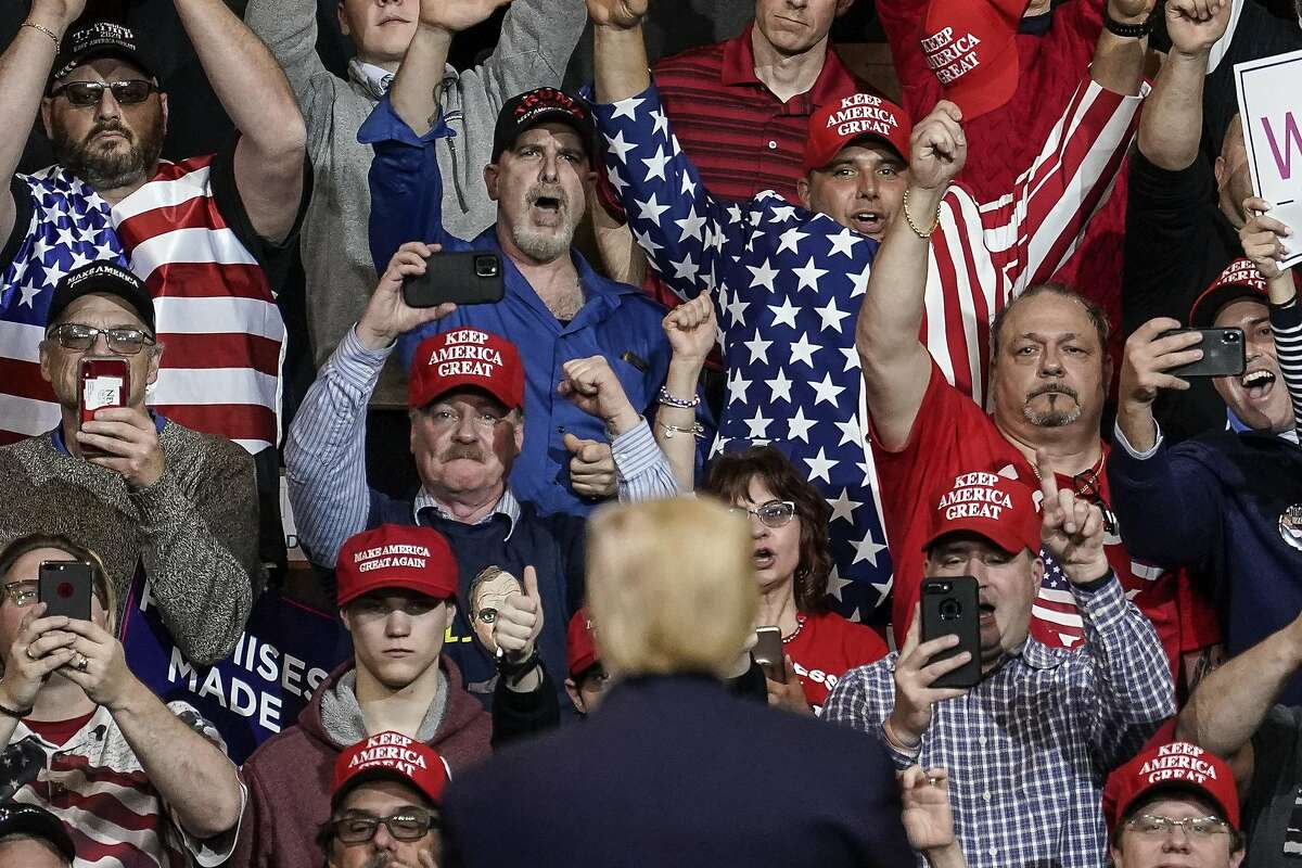 MANCHESTER, NH - FEBRUARY 10: Supporters cheer as U.S. President Donald Trump leaves a rally at Southern New Hampshire University Arena on February 10, 2020 in Manchester, New Hampshire. New Hampshire holds its first-in-the-nation primary tomorrow. (Photo by Drew Angerer/Getty Images)