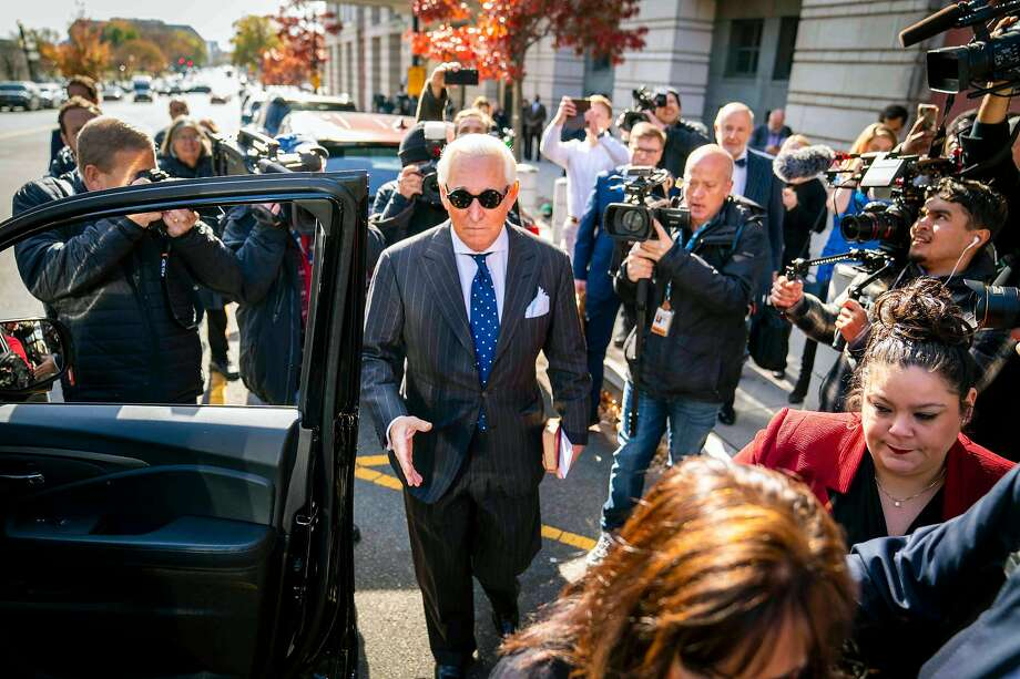 FILE -- Roger Stone, President Donald Trump's longtime friend, leaves federal court in Washington on Nov. 14, 2019, after being convicted of seven felonies for obstructing a congressional inquiry, lying to investigators under oath and trying to block the testimony of a witness. President Donald Trump on Wednesday, Feb. 12, 2020, congratulated his attorney general for intervening to lower the Justice Department's sentencing recommendation for Stone, broadening concerns that the department is ceding its independence to White House influence. (Doug Mills/The New York Times) Photo: DOUG MILLS;Doug Mills / New York Times