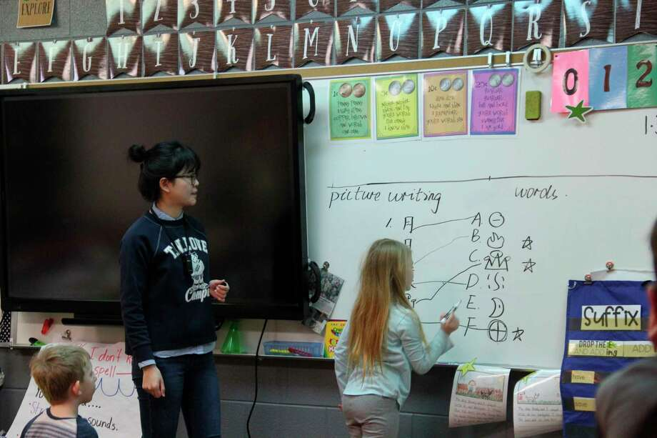 Lyu Chuanjing, better known to Laker Elementary students as Ms. Alice, teaches a lesson on Mandarin Chinese words back in January. She, and another Chinese teacher, had to cut their stay in Huron County short due to flight cancellations. (Robert Creenan/Huron Daily Tribune)