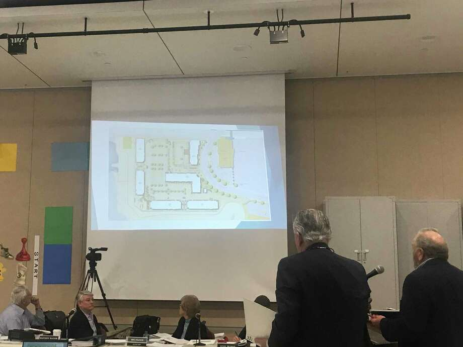 Representatives of Black Rock Realty Group present their plans for a five-building apartment complex and hotel across the street from the Fairfield Metro Center to the Town Plan and Zoning Commission on Tuesday. Photo: Josh LaBella / Hearst Connecticut Media