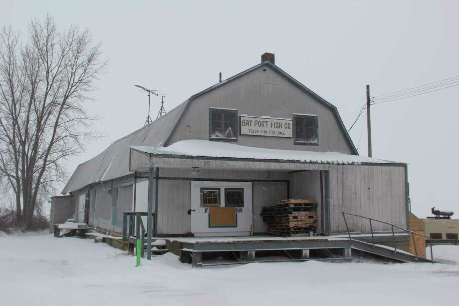 Bay Port Fish Company is closed during a wintery February day. The more than 100-year-old fishery may close permanently if new proposed state fishing regulations are put into effect. (Robert Creenan/Huron Daily Tribune)