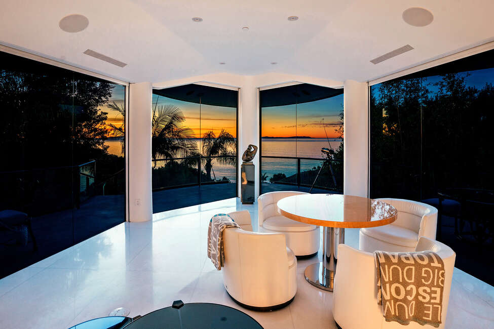 David Saperstein, the billionaire founder of Metro Networks, is seeking $115 million for his custom compound in Malibu's Paradise Cove. Saperstein's mansion measures more than 10,000 square feet and features glass catwalks, white marble floors and an 18-foot crystal chandelier in the foyer. (Aerial One Digital Studios/TNS)