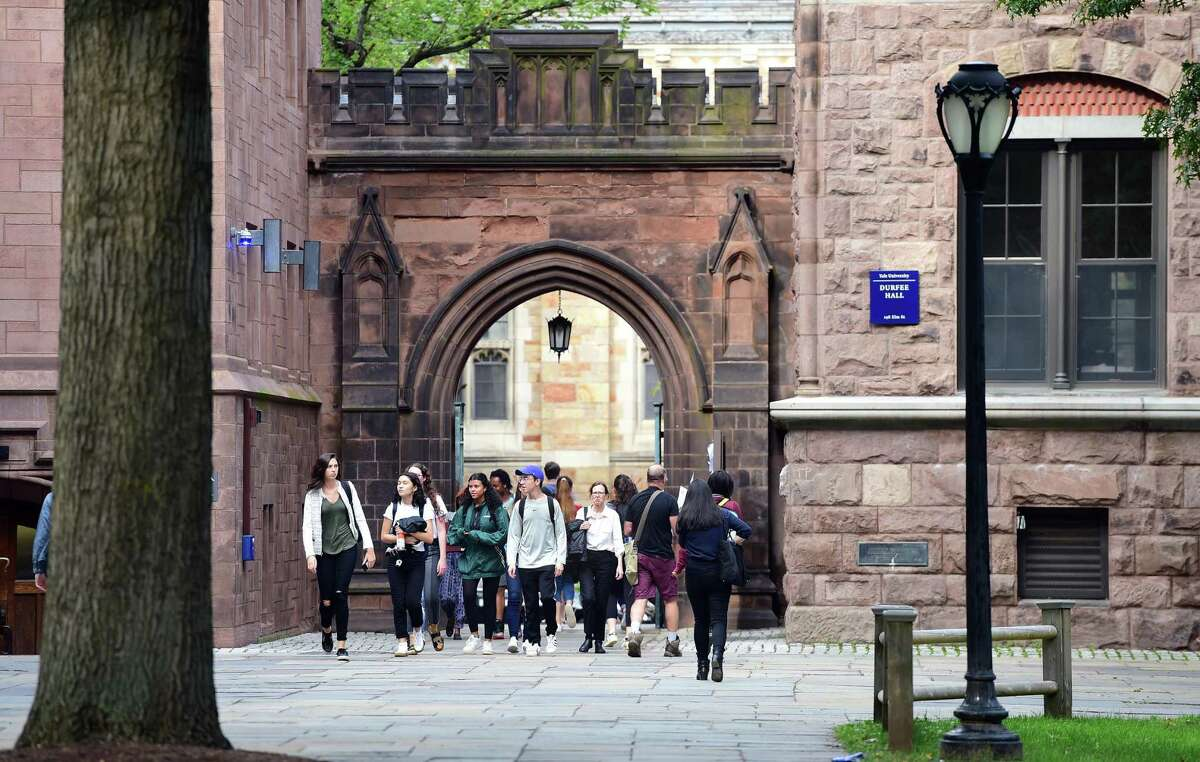 Students walk into Yale University's Old Campus in New Haven on October 2, 2018.