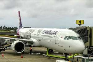 Hawaiian Airlines has replaced 18 widebodies with shiny new Airbus A321neo narrowbodies like this one here at Lihue airport in Kauai