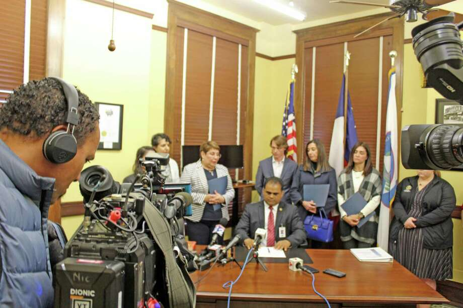 "Family members of the ""Citgo 6"" speak to reporters at a press conference hosted by Fort Bend County Judge KP George on Feb. 11. Photo: Kristi Nix"