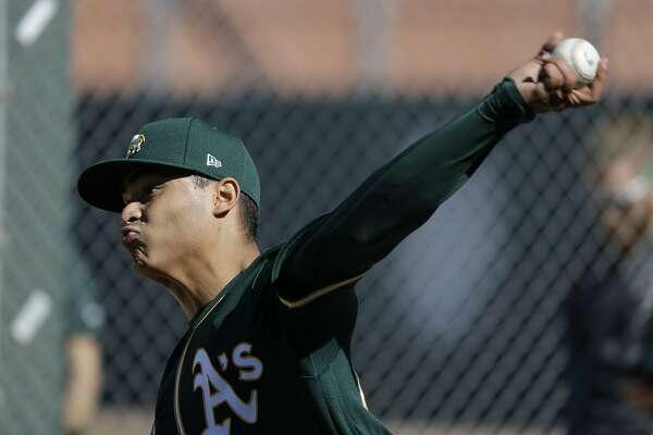 Oakland Athletics' Jesus Luzardo throws during spring training baseball practice, Thursday, Feb. 13, 2020, in Mesa, Ariz. (AP Photo/Darron Cummings)
