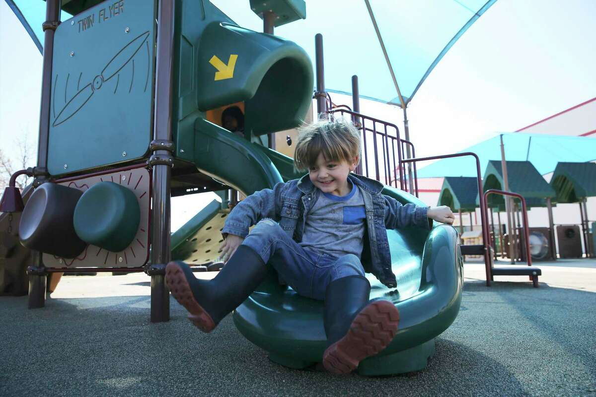 A student enjoys the slide at a Pre-K 4 SA center in February. The city's continuation of this program, along with workforce development and funding public transit, will create opportunities and prosperity. Texas, too, needs to take future-oriented action.