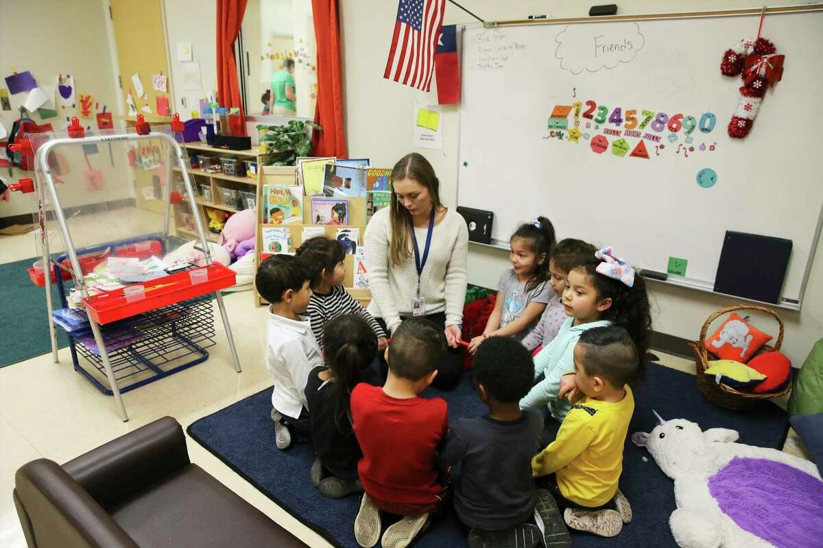 Teacher Meagan Mathers gathers her pre-kindergarten students after their naps to start an activity in class in this Feb. 13, 2020, photo. Keep Pre-K 4 SA has received nearly $770,000 in advance of the Nov. 3 vote on the proposition to renew the tax for the program.