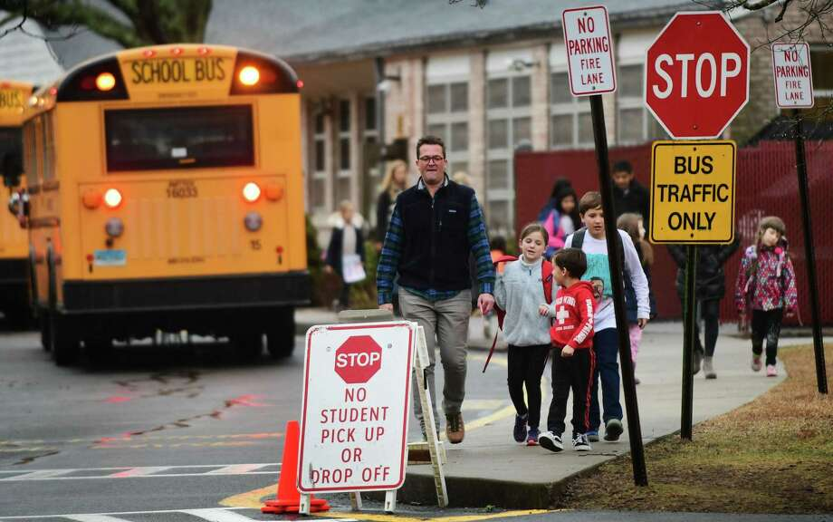 Students leave Coleytown Elementary School in Westport on Thursday. Photo: Erik Trautmann / Hearst Connecticut Media / Norwalk Hour