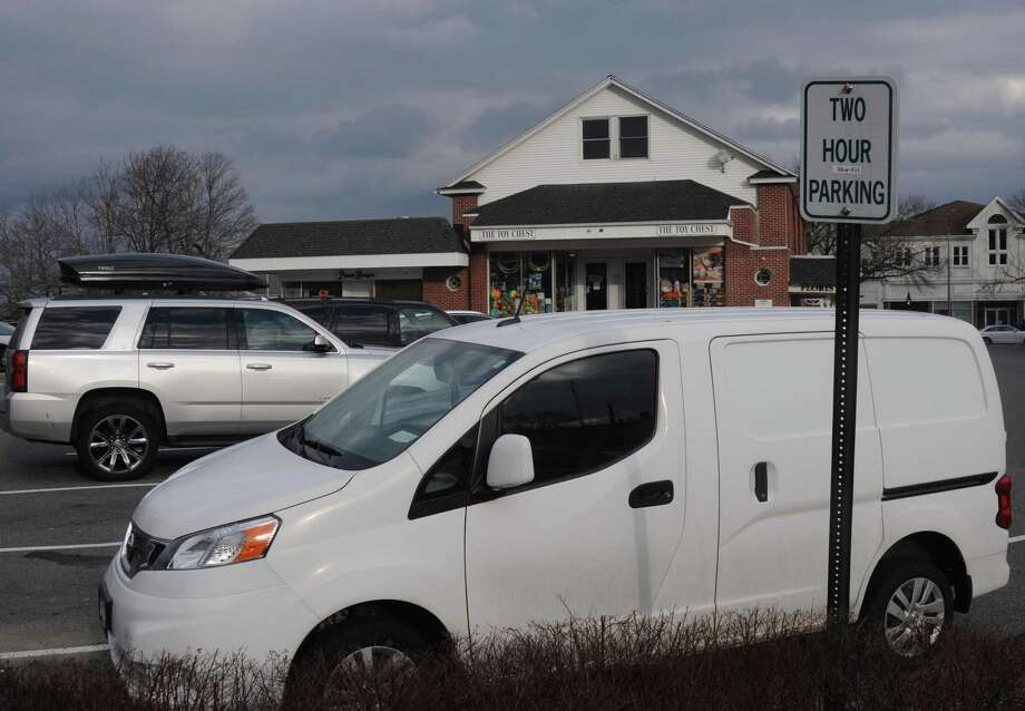 "New ""two-hour parking"" signs have gone up behind the Addessi Center. Photo: Macklin Reid / Hearst / Ridgefield Press"