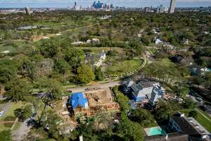 Construction continues on two homes near River Oaks Country Club, one new construction and one construction of an addition, Thursday, Feb. 13, 2020, in Houston's River Oaks neighborhood.