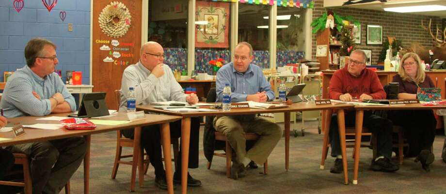 Manistee Area Public Schools Board of Education president Dr. Paul Antal (third from left) discusses the CareConnect program with superintendent Ron Stoneman (second from left) and members of the board. (Ken Grabowski/News Advocate)